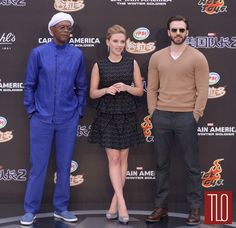 "Samuel L. Jackson, Scarlett Johansson and Chris Evans attend a press conference for their new movie ""Captain America: The Winter Soldier"" in Beijing, China. Samuel L. Jackson is wearing Giorgio Armani. Scarlett Johansson is wearing an Antonio Berardi dress paired with Christian Louboutin shoes and Tesiro jewelry. Chris Evans is wearing a Gucci sweater paired with Rag & Bone pants and Frye shoes."
