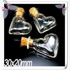 He encontrado este interesante anuncio de Etsy en https://www.etsy.com/es/listing/79950287/5pcs-30x20mm-heart-shape-glass-bottle
