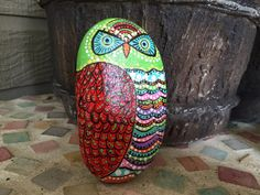 Colorful hand painted owl on flat stone