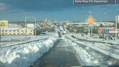 Route 66 Santa Rosa, NM with over a foot of hail on July 3rd 2013. Could this be Christmas in July.