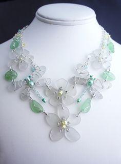 (http://www.camanocreations.com/sea-glass-dragonfly-and-flower-bib/)