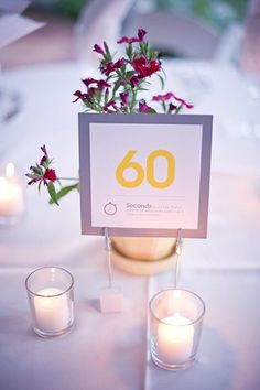 Yellow and gray table numbers, each representing a fact about the couple | photo by Harwell Photography