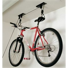 Hoist Monster | We sell bike racks by Racor to help save space in your garage, laundry room, closet, or mud room by hanging bikes from the ceiling or the wall. #BikeRack #GarageStorage