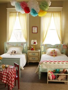 Girly bedrooms like the tall windows with nightstand between