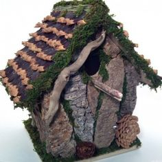 Decorative Birdhouse from pinecones and driftwood.