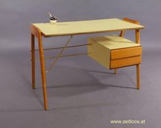 Italian writing desk,   unknowing producer,   Italian 1950.   Suspended drawers,   legs and drawers in solid beech,   writing plate laminated wood panel in citrus yellow.   Crood braces in brass.