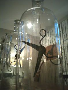 suspend items from top of cloche.. idea for those things that just don't look right laying down or standing alone.