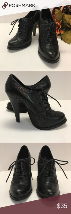 "Black Leather Wingtip Oxford Heels These shoes will be a smart addition to any work wardrobe!  They are all leather black wingtip oxford heels by Aldo.  The heel is 4"" and the shoes have leather shoe strings to tie on.  They are in excellent condition with no scuffs, marks, stains or damage of any kind. Aldo Shoes Heels"