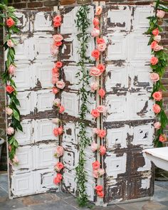 NOLA Flora dressed up an antique ceiling tile screen with leafy garland and peach 'Fado' and 'Movie Star' roses to act as the backdrop for the photo booth.