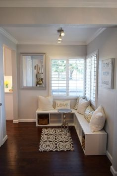 Create an easy window seating area with pillows for comfort, and baskets for decorative storage. A little rug and accent table complete the look. HomeGoods Sponsored Pin.