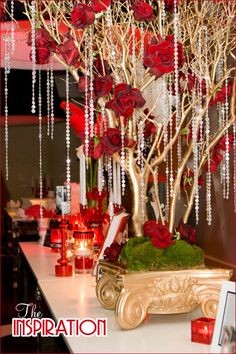 glamorous red & gold centerpieces… starting with the gorgeous crystal adorned tree pictured above, which was created by Tic-Tock Couture Florals
