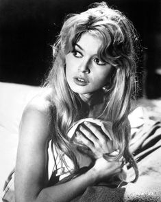 Screen bombshell Brigitte Bardot wears curtain bangs
