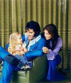 Elvis and Priscilla with little Lisa Marie.