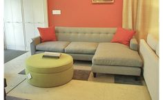 Sofa In The Corner Of The Room With A Good Design, And Memeiliki Gray Color, And At The Top There Are Two Sofa Cushions A Lovely Orange Color