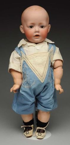 "Darling ""Hilda"" Toddler Doll. German bisque socket head by J.D. Kestner incised "" Hilda © JDK Jr. 1914 ges gesch No.1070 made in 12 Germany"" with solid dome head and painted hair, light multistroked eyebrows, sleeping eyes , painted upper and lower lashes, open mouth with 2 upper teeth, large ears"