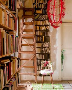 books everywhere plus a ladder. this space needs to be in my house.