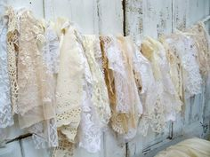 Shabby chic fabric garland wall hanging homemade romantic lace white cream vanilla home decor Christmas decoration Anita Spero. $125.00, via Etsy.