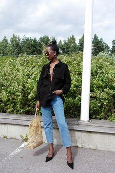 Straight leg jeans, oversized black shirt, basket bag
