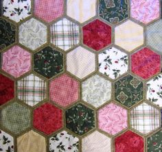 Quilt as you go hexagons. Just sew binding color of your choice and stitch together hexagons with mono filament.