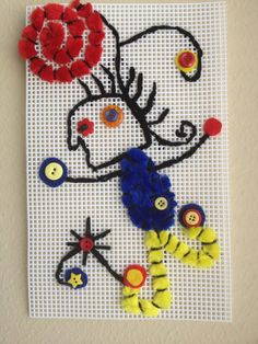 Miro inspired stitchery lesson. Students worked on plastic canvas with large plastic needles, used a back stitch or running stitch for most details. Added large shapes with felt and details with buttons and pipe cleaners.
