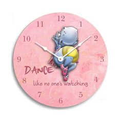 Brighten up your girls room with this colorful and fun wall clock featuring a dancing hippo with the text Dance like no ones watching  The