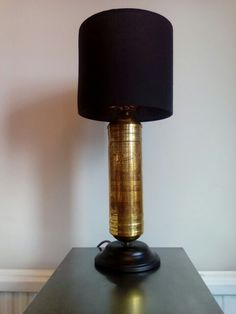 Refurbished 1956 pyrene fire extinguisher with shade converted to a table lamp. By Mike Bainbridge.