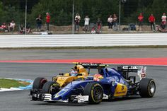 Felipe Nasr, Sauber C35 and Jolyon Palmer, Renault Sport F1 Team RS16 battle for…