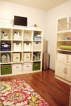 organized laundry room - love the wire baskets for paper towels, etc.