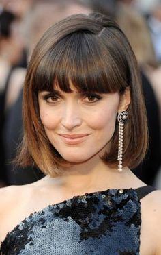 Rose Byrne, Oscars 2012  -->following text from Lucky Magazine: Harry Josh applied John Frieda Full Repair Style Revival on wet hair, then blow-dried it with a round brush, and then flat-ironed it just below her roots, so he didn't kill any volume. He kept her bangs in place with John Frieda Full Repair Flyaway Tamer.