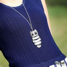 Looking for the perfect necklace to go with your outfit? We have the perfect suggestion for you! This vintage owl pendant necklace will look great with any style of outfit. Necklace is silver in tone with big blueish eyes. This piece offers  bit of an edgy style for when you are feeling bold, spices up your causal attire and is sure to turn heads!