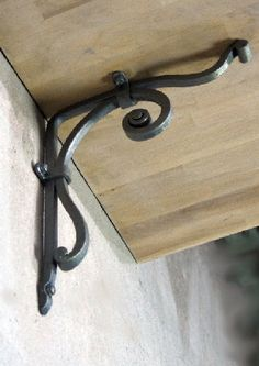 """Gorgeous and elegant hand forged wrought iron shelf bracket that will make great addition to your home! I only use traditional blacksmithing techniques in my works making contemporary look. No welding and etc.  For manufacturing that bracket I use a square bar 3/8 x 3/8. Standard brackets dimensions: 9 x 10"""" 10 x 12  The bracket on photo is painted a satin grey with patina. Other colors are available on demand, also patina. Just let me know what you need. The bracket has five holes...."""