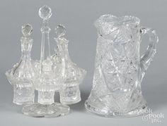 Cut glass cruet set, 10 1/4'' h., together with a pitcher, 9'' h. - Price Estimate: $40 - $60