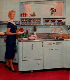 """Placement of the dishwasher and sink at an angle provides extra counter-top work space for the sink and the cooking area.""  ""Family Circle Magazine""October 1955"
