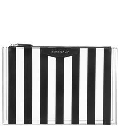 Givenchy - Antigona printed leather clutch - Clutch a touch of chic with Givenchy's sleek addition to the coveted 'Antigona' style. The streamlined silhouette is crafted in graphic black and white striped leather with the brand's logo subtly placed at the front. It's the ultimate day-to-dinner plus-one when you're looking to travel with no strings attached. seen @ www.mytheresa.com