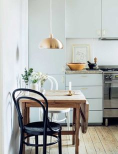 small kitchen with copper pendant lamp and black and white bentwood chairs. / sfgirlbybay small kitchen with copper pendant lamp and black and white bentwood chairs. Small Kitchen Tables, Kitchen Chairs, Small Kitchens, Small Table And Chairs, Kitchen Decor, Small Bathrooms, Small Tables, Ikea Kitchen, Kitchen Shelves