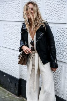 A Black leather biker jacket adds a cool twist to soft khaki linen trousers with…