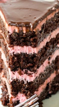 Chocolate Raspberry Cake ~ Moist and delicious chocolate cake layered with raspberry buttercream and drizzled with chocolate ganache... An amazing dessert!