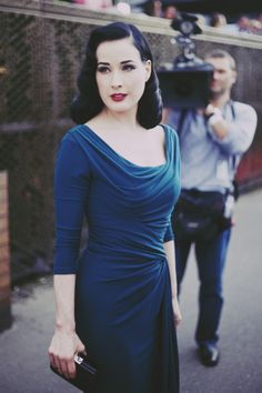 Dita in a gorgeous, fitted teal dress.
