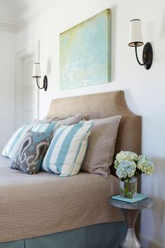 neutral headboard with a good shape that should still be easy to DIY. I love the color scheme!