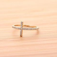 Cross Ring....perfectI am in love with the sideway crosses that you can wear now days! Cant get enough of them including bracelets and necklaces!