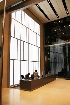 """LED Light Wall at """"The Helicon"""" 1 South Place, London. This features an aluminium curtain walling system holding onyx glass laminate. WIthin the structure LED Light Panels evenly provide feature illumination and bring out the depth in the natural stone."""