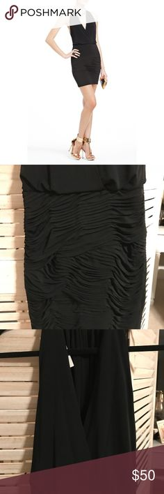 BCBG Lbd Great little black dress! Closure at the neck with gorgeous open back and side detailing. Fits like an XS BCBGMaxAzria Dresses Midi