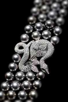Boucheron Black Pearl and Diamond snake bracelet. I love black pearls and snake jewelry. When you put them together, it's completely fabulous, don't you think?