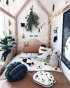 From the Inside blog | How to decor your home with Scandinavian design Inspirations  | It's possible to have a kid's bedroom with a Scandinavian design inspiration. You can choose adorable pastel colored decorative elements like pillows and stuffed animals. You can also rebel yourself and go with bold wall stickers that your kid will love.