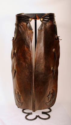 Vintage chaps make wonderful decor, their worn leather with warm patina and special details, particular to the cowboy whose legs they protected, all make for unique charm. This pair of Miles City Saddlery batwing chaps of Miles City, MT are stamped with the makers mark. luckystargallery.com $865
