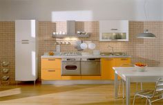 Kitchen in dark yellow high gloss shutters with Frosted glass touch in brod handles. For more details visit: http://kitchenz.biz