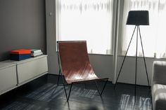 This leather chair is right at home with the dark wood floors in this SOHO loft.