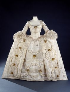Womans overdress or robe à la française with petticoat Spitalfield Brocaded silk trimmed with lace, gauze and silk flowers circa 1780-1785