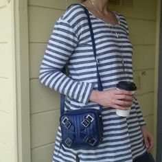 """Anthropologie Schuler & Sons bag Genuine blue, soft leather with silver toned hardware all over. Due to the nature of the soft leather, there are a few tiny scratches. I am in love with the simple, edgy ease of this bag. Soooo versatile. Im 6'2""""...it was not comfortable as a croasbody, but great as a shoulder bag. Adjustable straps, adorable printed interior. No smells or stains inside. Brand is Schuler & Sons. Anthropologie Bags Shoulder Bags"""