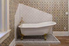 Neat use of tiles against wallpaper. Doesn't need to be a square!